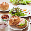 Breakfast with hamburger, tea, egg and green salad - Foto de Stock
