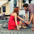 Man fell down from the bicycle and woman help him to collect products — Stock Photo #25724867