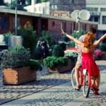 Couple have fun riding on bike — Stock Photo