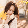 Autumn woman in yellow leaves portrait — Stock Photo