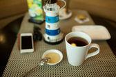 Tea with honey on wood table — Stock Photo