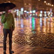Man with umbrella in a city street — Stock Photo #29231265