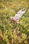 Young boy in flowers — Stock Photo