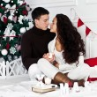 Stock Photo: Young couple under new year tree