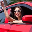 Happy smiling woman in a car. Driving. — Stock Photo
