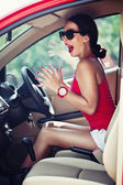 Emotional woman in panic is driving the car — Stock Photo