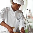 Asian chef laying a table with luxury food and drinks on wedding. — ストック写真