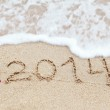 New year 2014 digits on ocean beach sand — Stock Photo #35631033