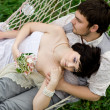 Young couple Relaxing In spring Hammock — Stock Photo #37411919