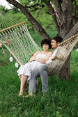 Young couple Relaxing In spring Hammock — Stockfoto