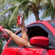 Legs showing from red car. — Stock Photo #41086251