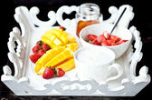 Healthy breakfast with mango, strawberry, honey and cereal — Stock Photo