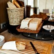 Assortment of fresh pastry on table in buffet with toaster — Stock Photo