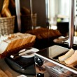 Assortment of fresh pastry on table in buffet with toaster — Stock Photo #42332783