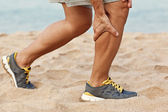 Cramps in leg calves or sprain calf on triathlete runner. Sports injury concept with running man. — Stock Photo