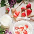 Healthy breakfast with strawberry, cottage cheese, honey and cream. — Stock Photo