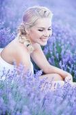Romantic lady in lavender field — Stock Photo