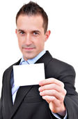 Young business man showing off his blank business card that is ready for text — Stock Photo