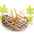 Easter egg in wicker basket — Stock Photo #19304119