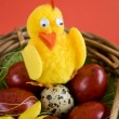 Easter eggs and artificial chicken — Stock Photo