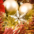 Stock Photo: Christmas baubles and ribbons on red background