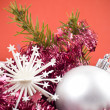 Christmas baubles and ribbons on red background — Stock Photo