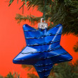 Blue stars hanging from christmas tree — Stock Photo