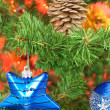 Blue star hanging from christmas tree — Stock Photo