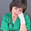 Attractive lady doctor on a over gray background — Stock Photo #19308903