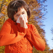 Pretty woman sneeze. Allergy season  — Stock Photo