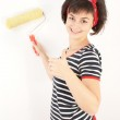 Pretty young woman with painting roller isolated on white — Stock Photo