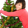 Stock Photo: Young woman decorating christmas tree