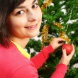 Young woman decorating christmas tree  — Stock Photo #19309611