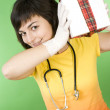 Medical doctor with gift box  — Stock Photo