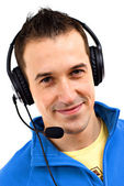 Young friendly man with headset on white background — Стоковое фото