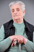 Portrait of grey haired woman looking at camera — Stock Photo