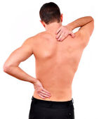 Young caucasian man with pain in a back isolated on white — Stock Photo