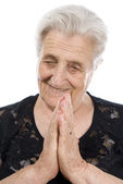 Old, attractive Caucasian woman praying — Stock Photo