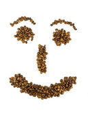 Smile from coffee beans isolated on white — Stock Photo