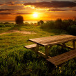 Stock Photo: Park bench at sunset