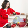 Christmas girl and gift — Stock Photo #15551545