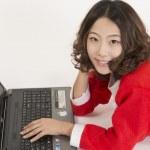 Christmas girl with computer — Stock Photo #15559095