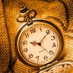 Pocket watch with gunny — Stock Photo