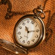 Pocket watch with gunny — Stock Photo
