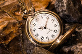 Pocket watch with rock — Stockfoto