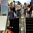 Customers on the escalator in Oriental Plaza,Wangfujing,Beijing,China — Stock Video