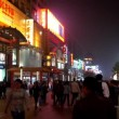 People roam Wangfujing Walking Street at night,Beijing,China — Stock video #33354291