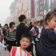 During holiday,people roam Wangfujing PedestriStreet,Beijing,China — Stock video #33364387