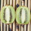 Stock Photo: Two halves of kiwi