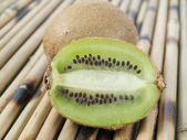 Kiwi on a table — Stock Photo